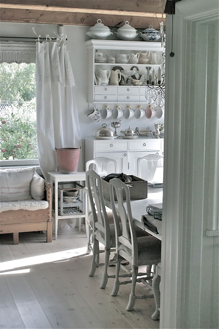 ~ go with light raw wood & lighter colors. paint chairs various shades of green to match trees outside the window.