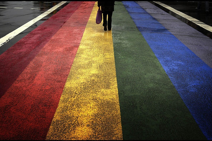 A pedestrian walks across a painted rainbow crossing on Sydneys Oxford street, the citys main gay district April 4, 2013. Officials have ordered the removal of the rainbow crossing, setting off fierce debate in a city known for its annual Mardi Gras gay pride event, one of Australias main tourist draws.