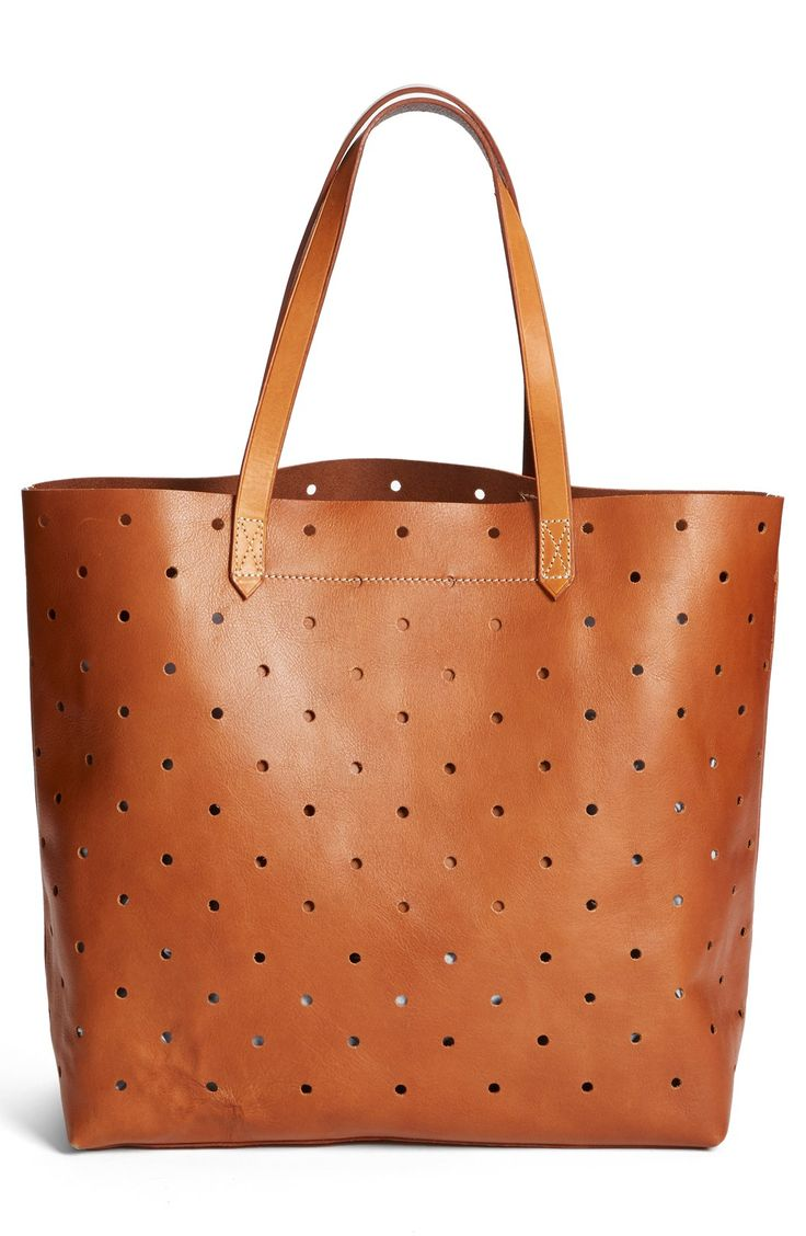 Sporting this Madewell perforated tote with boyfriend jeans and espadrilles.