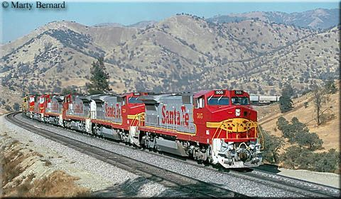 A parade of B40-8Ws and other power leads a Santa Fe freight near Walong, California on October 16, 1992.