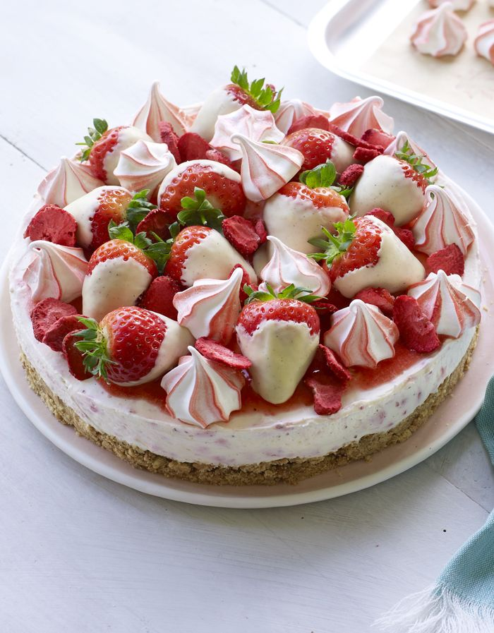 An Eton Mess cheesecake with stripey meringues, choc-dipped strawberries and a buttery biscuit base. That's an ace!