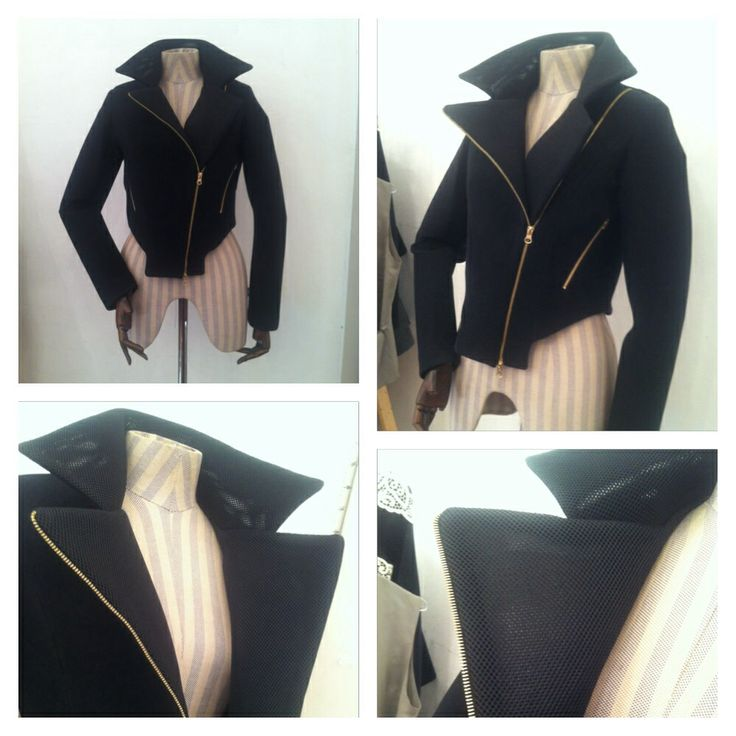 Black Neoprene Jacket with detailed collar and metallic zipper.