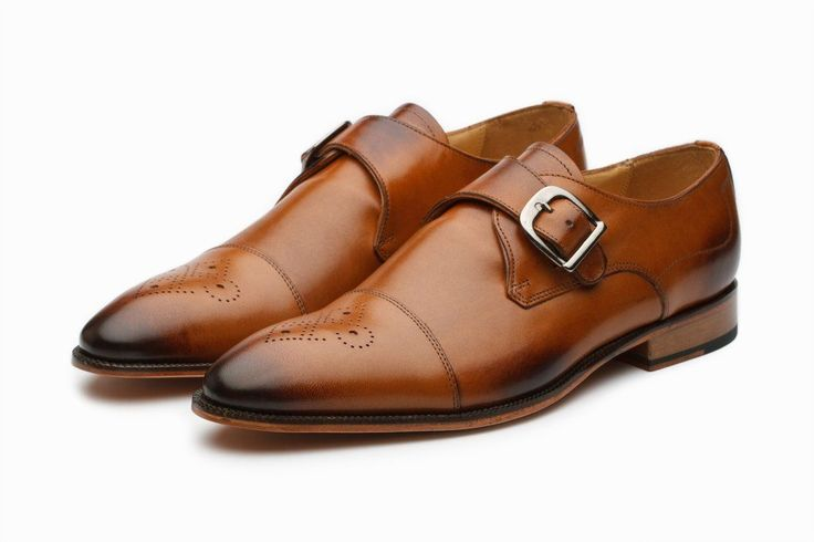 Do you love monk strap leather shoes but can't find any that fit just right? I love the look of the monk strap shoes but could never just find ones that fit me correctly. Most rub my ankle bone or are too small in the heel. Well that is until I found these from 3DM. These 3DM Lifestyle Single Monk Straps feature medallion flower perforations on the toe with a darker tan to accent the cap point.