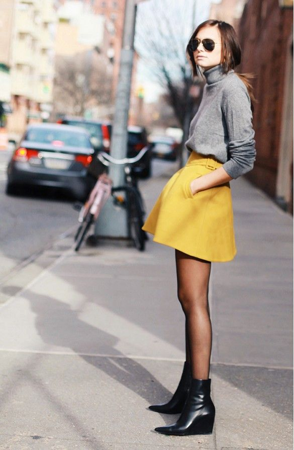 Grey turtleneck and yellow skirt with black wedge ankle booties