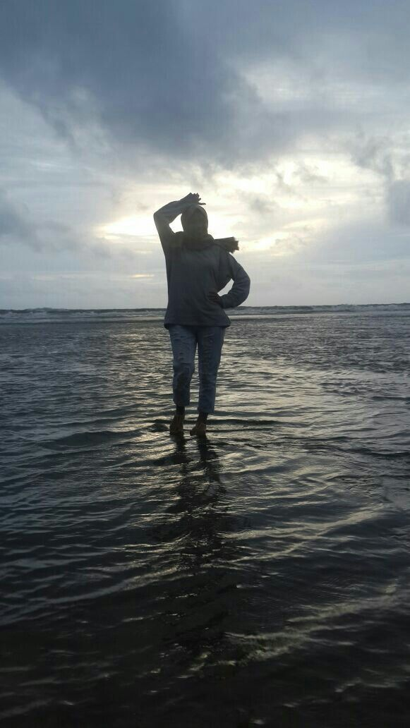 Standing in the water