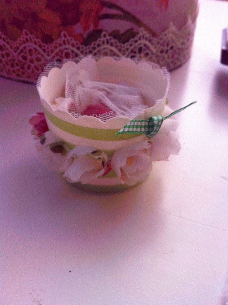 I decorated little cupcake holders and filled them with scrapbook treasures including lace, ribbons, embellishments.