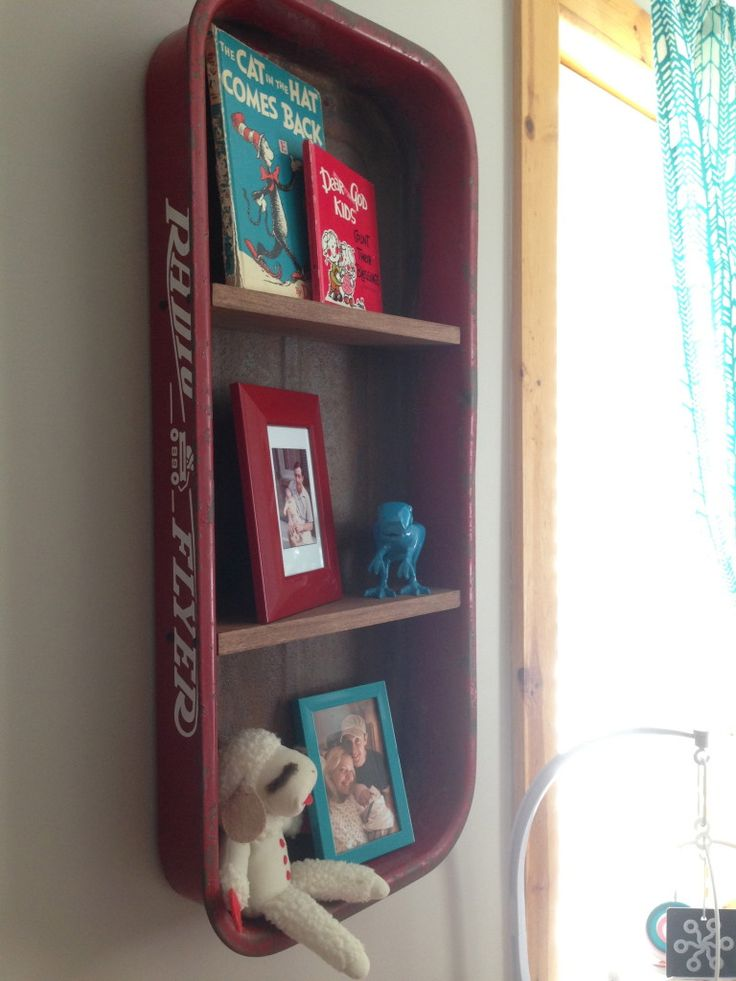 Design Tip: Use something unexpected for wall art in the nursery! We love this Radio Flyer wagon repurposed for a wall shelf. #nursery #walldecor