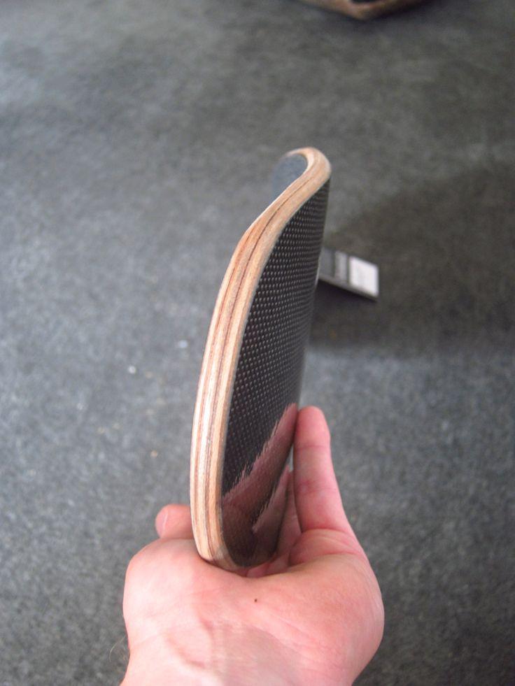 Custom hand-engineered carbon fibre longboards  whiteroselongboards.com