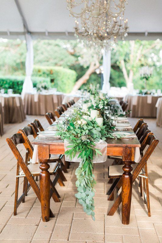 Greenery wedding centerpiece idea - long, wooden tables with greenery garland centerpiece {Pearl Events Austin}