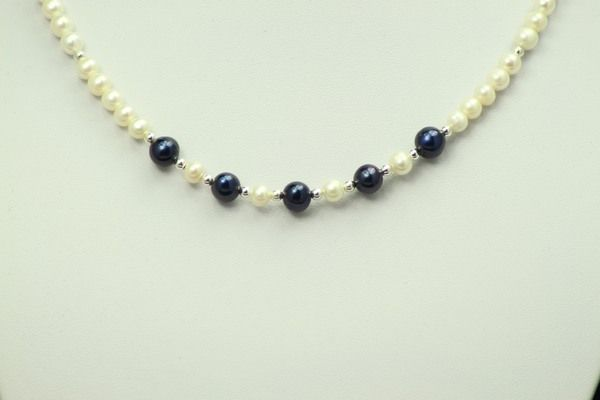 Arista Necklace is a classic necklace of midnight blue and white potato pearls.  Beautiful classic necklace which is designed to sit on the collarbone.
