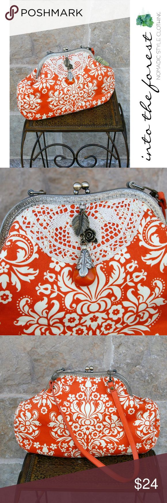 """NWT Orange Blossom Bag with Stone Charm Boho beauty! New With Tags. Retail $65.00. Vintage crochet doily as accent. Resin bead and metal charms on tassel. Vinyl strap. One zippered pocket inside. ● Width 14"""", Height 9"""", Depth 2"""", Strap Height 12"""".  ● Cotton/Polyester blend outer.  ● Smoke-free home and fast shipper! Bags Shoulder Bags"""