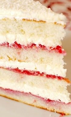 Raspberry Lemon Coconut Cake - filling is layered raspberry preserves and on top of that a lemon buttercream layer