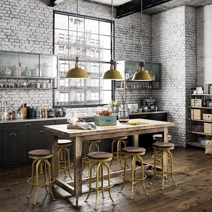Precioso comedor de estilo industrial en el que la pared de ladrillo visto, los techos altos, las lámparas colgantes, la mesa de madera, la ventana de cuarterones y los taburetes consiguen crear una atmosfera con un gran factory feeling.