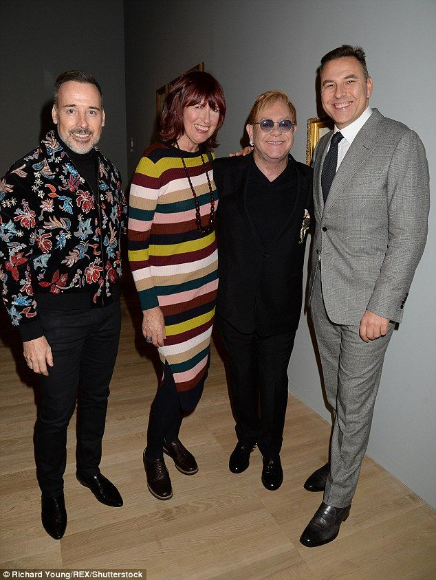 All smiles: David Walliams beamed as he posed alongside David Furnish, Elton John and Janet Street Porter at a photography exhibition in London - just a day after a High Court divorce settlement with his supermodel ex-wife Lara Stone