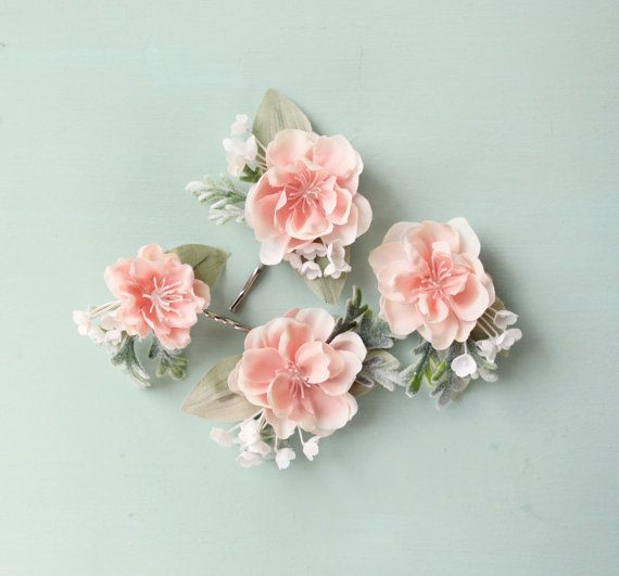 This hair pin set features gorgeous pink flowers that are the softest pastel pink ever! They each have a little base of a sage green vintage leaf,