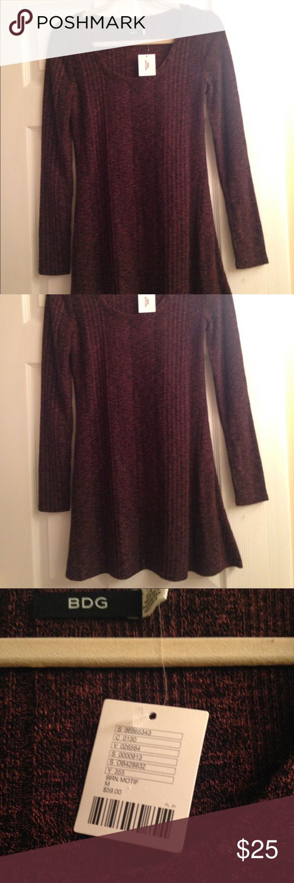 "NWT Urban Outfitters BDG Marled Sweater Dress A brand new, never worn Sweater dress from the urban outfitters brand, BDG. The color is a marled mix of a deep(almost burgundy) brown with black. I am 5'5"" and this hits above the knee on me. The fit is slightly swingy, but fitted around the bust and arms. BDG Dresses"