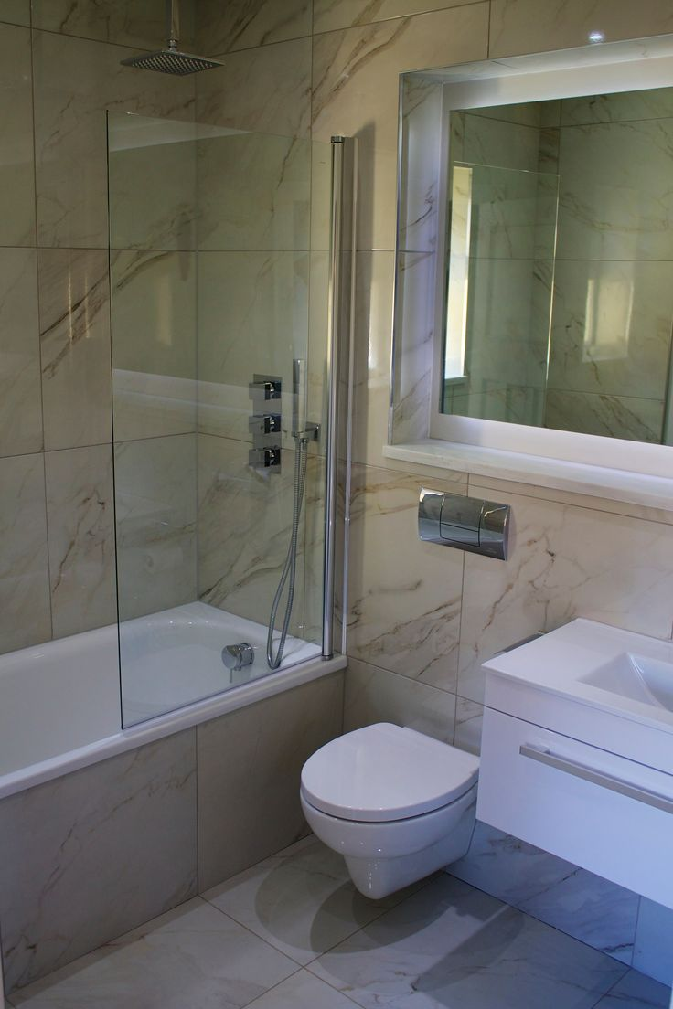 Carrara marble tiles with Porcelanosa sanitary and brassware