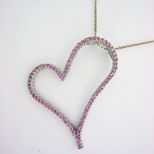 Sterling Silver Heart shaped Pendant with Pink Sapphire accents, weights 10 gram, comes with sterling silver chain.