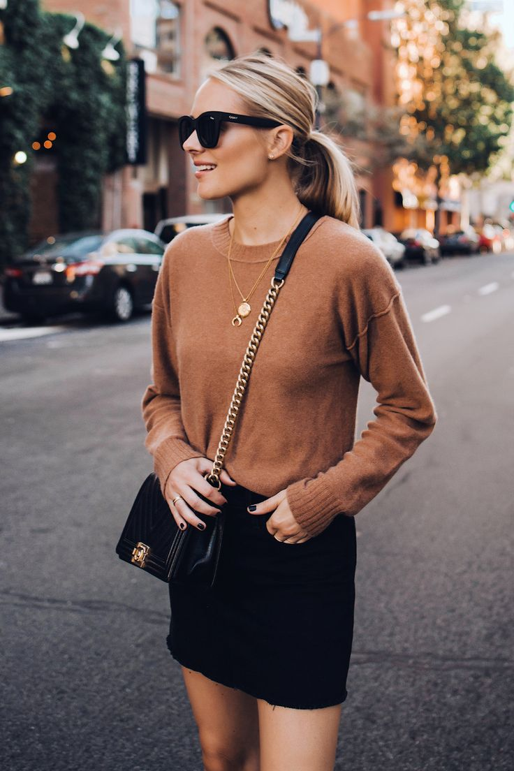Blonde Woman Wearing Free People Tan Sweater Black Denim Skirt Outfit Chanel Bla…