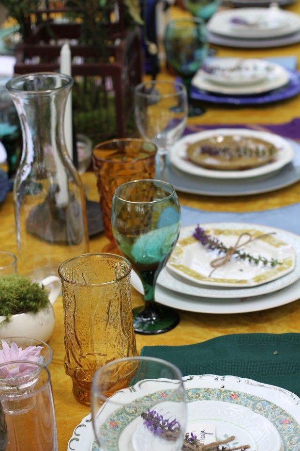 Love the shabby chic mismatched table settings. The bride got them from Goodwill, and donated them back at the end.