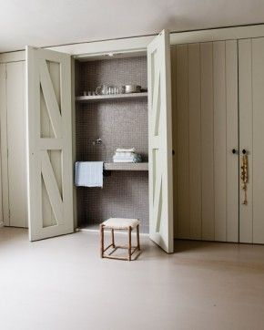 slimline utility room - part of the kitchen fittings - simply open to use - don't have to waste space taking up a whole room