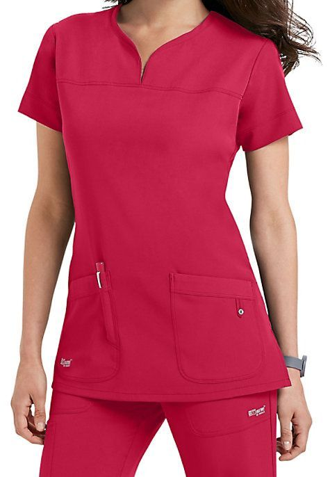 DISTINCTIVE AND DIFFERENTMake your job easier with the Grey's Anatomy Signature notch neck 2-Pocket scrub top! It has a four-way stretch fabric that's long on style and short on maintenance. Detailed pockets have an extra slot just for pens, and our notched neckline and front and back yokes make this a standout in the office or on the floor. Grey's Anatomy Signature Notch Neck 2 Pocket Scrub Tops Notch neck Front and back yokes Fitted back Two pockets 71% polyester/ 2...