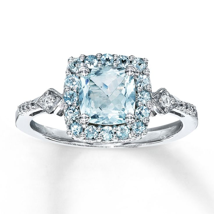 Lovely A cushion cut aquamarine is framed by round aquamarines in this exciting ring for her The sterling silver band is decorated with round lab created white