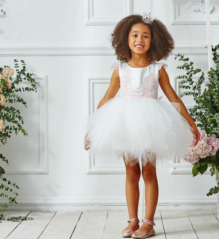 Pixie Tutu Dress-Made To Order - High Quality Cute Lace Applique Round Neckline Sleeveless Above The Knee - Knee Length Little & Big Girl Party Tutu Pixie Dress. Available from 3 until 13 years. Material: Cotton, satin & tulle mesh. Colors: White & Light Pink. Please do compare your little girl's measurements with our size chart.