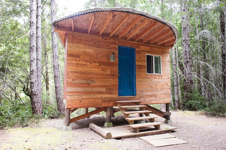 """$68 half-moon cabin in Gasquet, United States. A small, rustic, handbuilt cabin deep in the Northern California woods.  Part of a remote, off-grid """"village,"""" including a few other cabins, chickens, dogs, frogs, cats, permaculture gardens and all kinds of cool, sustainable, DIY infrastructure. ..."""