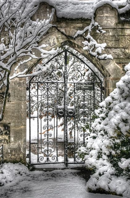 A wrought-iron Oxford gate on a snowy winter day. In The Last Enchantments there's a huge college-wide snowball fight...