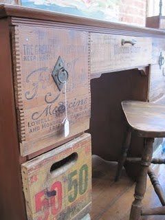 crate front desk ~ use the graphic sides of old crates for drawer fronts!