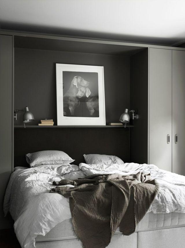 Dark bedroom with built in cabinets 156