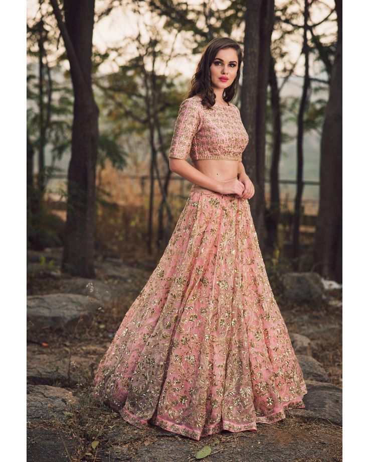 Beautiful blush pink color designer lehenga and blouse with hand embroidery zardosi work. Lehenga and blouse from Mallika Meenakshi collection ofMrunalini Rao. Photography by Akshay Rao. 25 December 2017