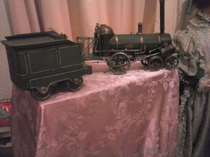 Minature Steam Train With Two Freight Carriages