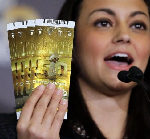 Dolores F. Dibella, NFL Counsel, holds up authentic Super Bowl 50 tickets during a counterfeit merchandise news conference Thursday, Feb. 4, 2016, in San Francisco. (AP Photo/David J. Phillip)