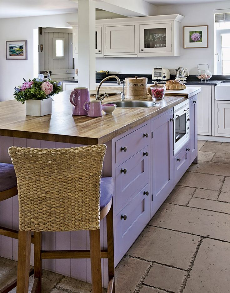 Country kitchen with painted island unit...for some unexpected reason I love the purple!