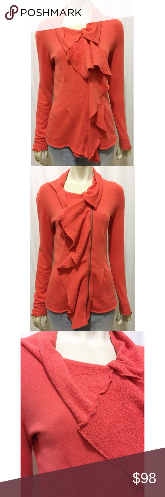"""We The Free Small Orange Pacific Coast Ruffle Coat Good used condition orange sweater jacket from We The Free by Free People. Size small. Asymmetrical concealed zipper with ruffle front, faux front pockets, pleated back, raw edges and rolled hem. Some pilling and a small hole behind the zipper - hole is not visible when item is on. 100% cotton. All measurements are approximate taken while garment is flat: length 25.5"""", bust 16.5"""", armpit to wrist 20"""". Free People Sweaters"""