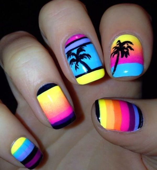 Boldly colored Palm Tree Nail Art design. The dark silhouette of the nail polish design is met with a contrasting burst of colors in neon. The contrast looks amazing and it gives life to the nails.