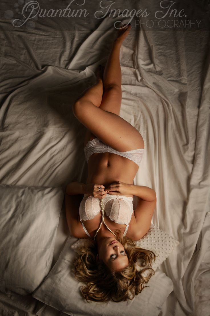 Boudoir photography photographer Quantum Images Inc. traditional boudoir is simply bra & panties in bed = beauty