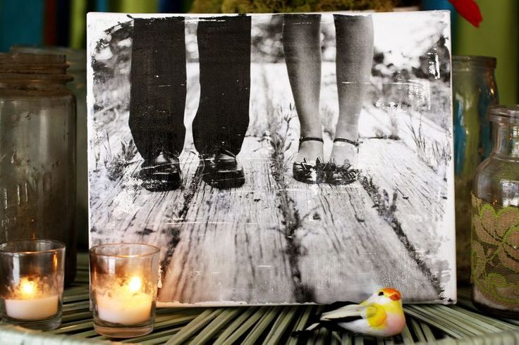 How to transfer a photo to canvas (this is like the DIY transfer a photo to wood I pinned).  You could also just carefully ModPodge a photo on if you weren't going for the rustic look - I know someone that did that and it turned out great.)