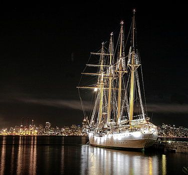 Alex Lyubar Fine Art Photography. Photograph - Sailing ship at the pier by Alex Lyubar #AlexLyubarFineArtPhotography #BlackSky #ChileanSailingShip #Esmeralda #NightScene #ArtForHome #FineArtPrints