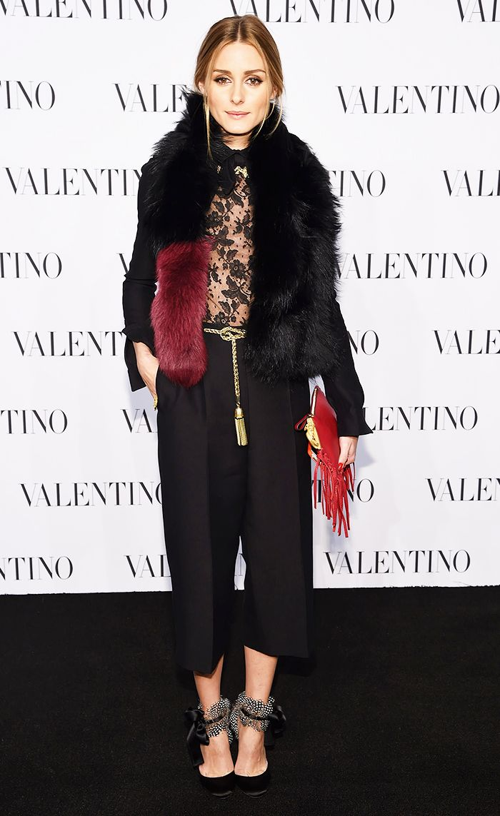 Olivia Palermo wearing a Valentino jumpsuit and Scarab Fringed Leather Clutch, Aquazzura heels, Charlotte Simone Popsicle Scarf at a Valentino event