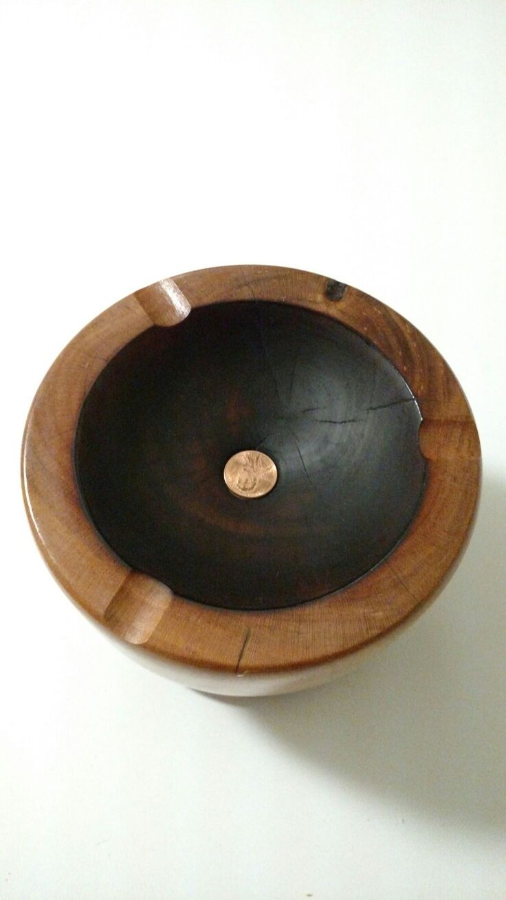 Cherry wood cigar ashtray. Cigar holders, charred dish, penny for putting out cigar and date it was made.