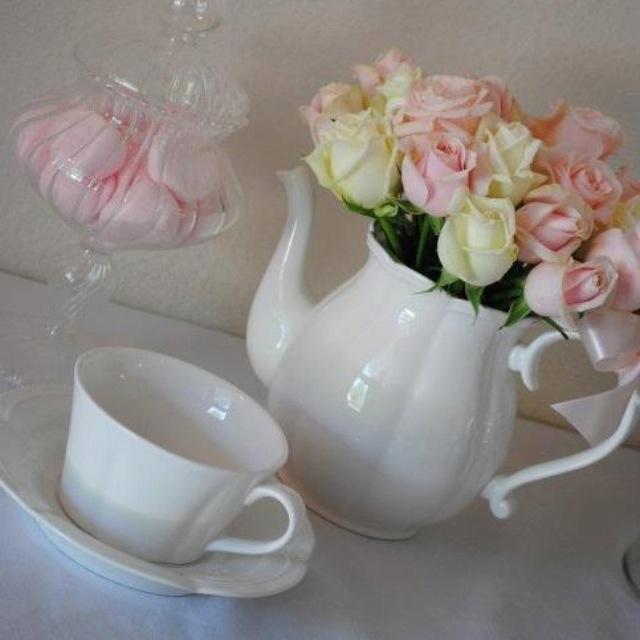 Flowers in a tea pot - table centerpieces