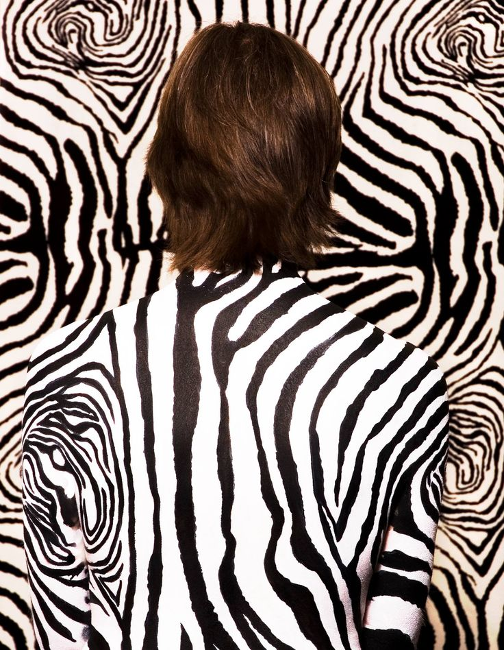 Camouflage Body paint. Bodypainted model  hidden seamlessly into zebra print by Bodypainter Emma Cammack for FABAIC