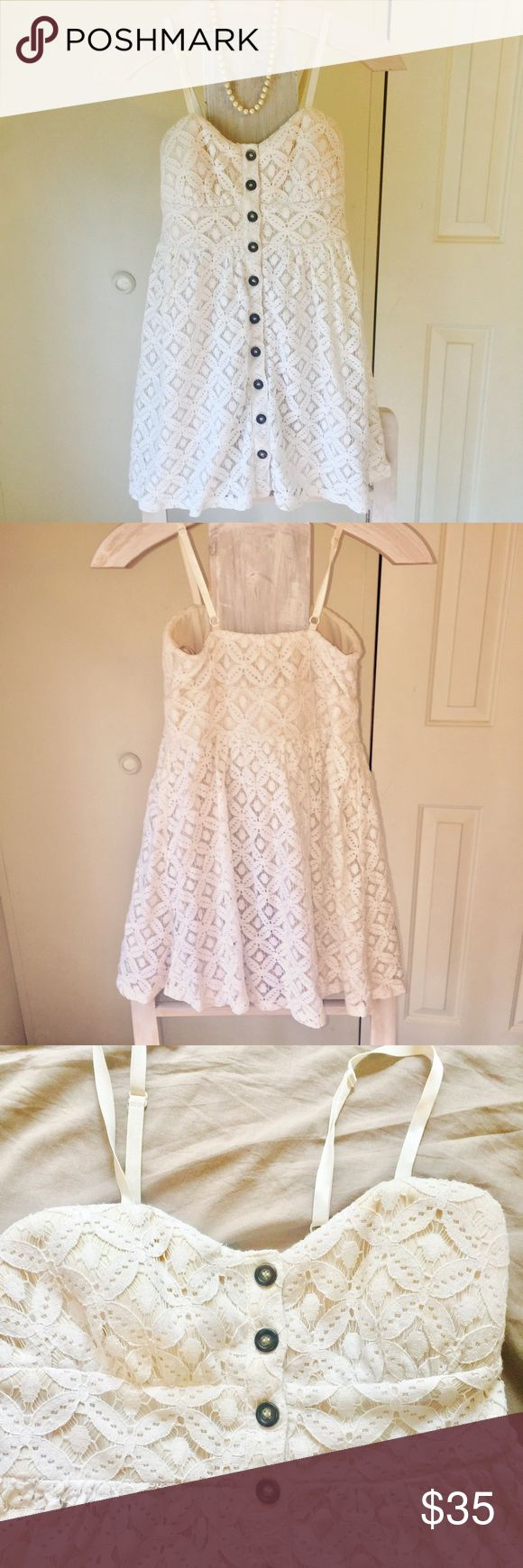 💄Elegant boutique summer dress💋 So elegant! Dress it up or down. Great condition!! It is an ivory color dress with built in slip, and a detailed lace overlay. It has adjustable straps and has dark brown buttons from top to bottom. The chest area has a little padding. Adorable!! Dresses