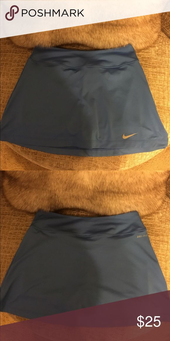 Nike Columbia Blue Dri-Fit Tennis Skirt Like new, only worn once, Nike Columbia blue tennis skirt with built in shorts! Perfect condition!! Size small Nike Skirts
