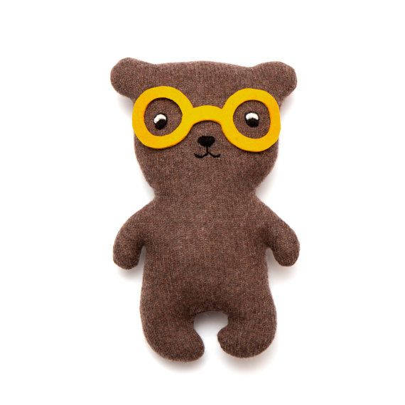 Meet Bob  Bob is knitted with a lovely soft lambswool and is filled with polyester stuffing. His face is hand embroidered and his glasses are made from