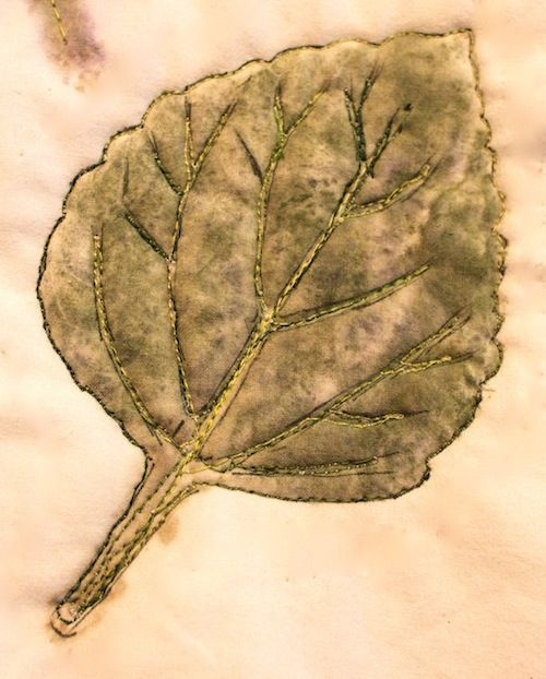 This leaf is made by hammering an actual leaf onto the fabric to create a print, and then #quilting the outline and veins: