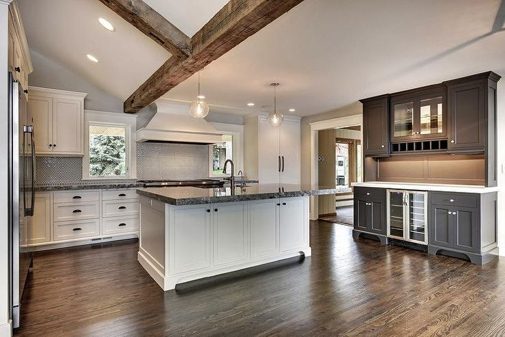Black And White Kitchen Features Rustic Wood Ceiling Beams